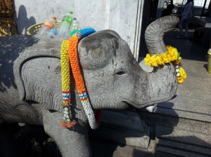 elephant gets flower offerings